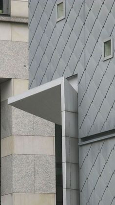 More zinc/metal facades · More antracite/black colored buildings · More offices…