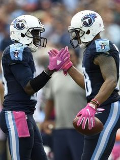 Browns vs. Titans:      October 16, 2016  -  28-26, Titans  -       Titans wide receivers Kendall Wright (13) and Rishard Matthews (18) celebrate a play in the third quarter Sunday.  George Walker IV / The Tennessean