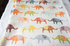 Rainbow Organic Baby Blanket: Circus Troupe on Elephant Parade printed on Cotton Jersey with cream Poly Fleece blanket.