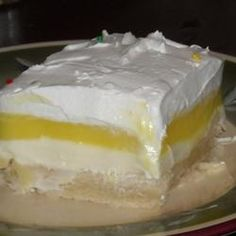 Lemon Lush - This was so delicious! I decided to make a graham cracker crust instead of a flour/butter crust and I also used a canned lemon pie filling instead of a pudding mix, Very nice lemon flavor, balanced with the cream cheese.