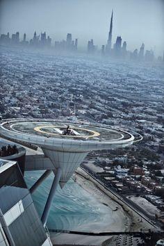 Danny Torres on the Burj Dubai Heli-pad viewing the Burj Khalifa, Dubai UAE - Investors Europe Stock Brokers Gibraltar