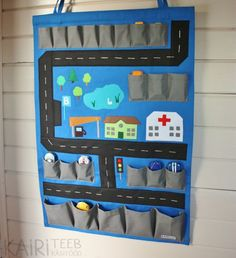 MADE TO ORDER! Will be ready for shipping in 1 - 2 weeks. 2in1 toy car organizer and playmat. Use on floor to play and simply hang it on wall to clean up the room! Organizer has 22 pockets in 3 different sizes. They can be used as garages while playing on floor. 2 loops for hanging. Wooden stick inserted into tunnel on top to make it hang straight. Playmat is made of polyester, pictures are made of felt. Use damp cloth to clean or gentle hand wash. Do not machine wash! MEASUREMENTS Width ...