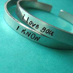 Han and Leia aluminum cuff bracelets.