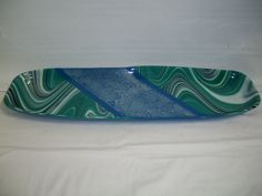 """Full fused and slumped bread platter, made by a student in our Friends Night Out """"Fused Glass Bread Platter"""" class. Platter measures 23""""x7""""."""
