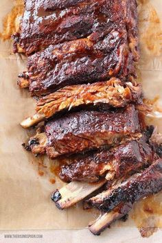 Crock-Pot BBQ Ribs - Fall-off-the-bone tender pork ribs cooked in the crock-pot. Super easy recipe takes less than 10 minutes to prep. #Bbqribs