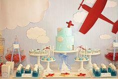 "We have been showing you transportation inspired parties this week. This airplane themed party was sent to us by Amanda of Red Wagon Events. She styled this party for her nephew's first birthday and we think it soars! The theme was ""How Time Flies"". The little passengers had four areas to go to: Check In, Jackson Airway's …"