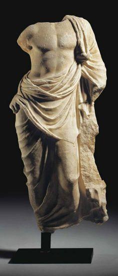 A ROMAN MARBLE AESCULAPIUS  CIRCA 1ST CENTURY A.D.