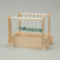 Make your own Newton's cradle! You can learn about the law of conservation of momentum. http://www.artec-educational.com/newtons-cradle-assembly-kit/