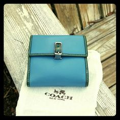Wallet Coach Blue green leather signature lining Coach wallet in very good condition unique spring flip closure. Change bill and credit card slots. There is little evidence of normal wear. Coach Bags Wallets