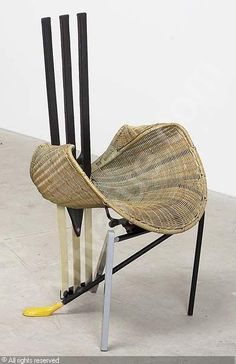 Documenta chair by DEGANELLO Paolo (Italy).  ca. 1987.  Leather, brass, wicker, metal, laminated wood