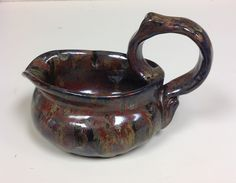 Thrown & hand built small pitcher. High school ceramics.