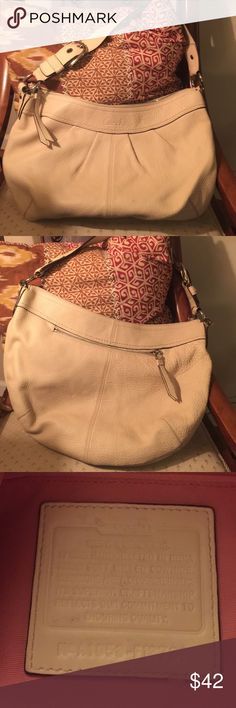 "Coach handbag Beautiful leather coach bag in creamy winter- white! In GUC. Pink lining in clean condition. Silver hardware. Approx 17"" wide, 12"" deep, adjustable strap with approx 12"" drop.         Shows some normal wear and tear on bottom of bag otherwise no issues. Awesome bag at a great price! Coach Bags Shoulder Bags"