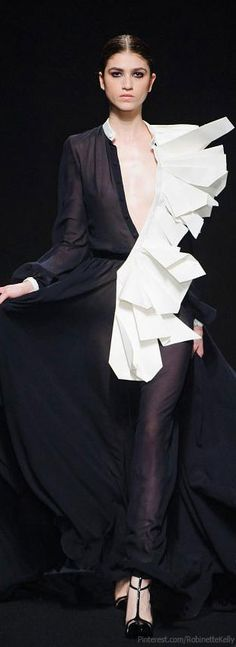 She fell into a paper shredder bin and decided to just go with it  Stephane Rolland Haute Couture | F/W 2013