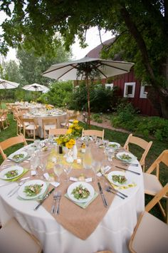 Rustic-Wedding-Tablescape  This is how we will do the table settings, umbrellas to the side