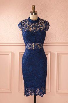 L'intrépide élégante affiche ses couleurs avec conviction. The elegant intrepid shows her colors with conviction. Deep blue lace stand collar fitted dress www.1861.ca
