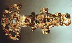 Ostrogothic fibula from the 6th century AD, made of gold and inlayed with enamel, garnet and emerald.