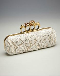 alexander mcqueen knuckle lace clutch for $3145...nice bag handle idea..but not $3145 nice!