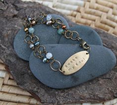 yes. these words. a reminder every day to pay attention :: awake my soul is inspired by mumford and sons and the colors of the stones along Puget Sound (a hand stamped soul mantra bracelet)