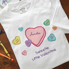 Awww! This cute little candy hearts design is adorable! This would be a cute Valentine's Day gift to give to your kids! You can personalize it with their name and it comes on baby clothes, bibs, and all different kids' sizes! LOVE IT!