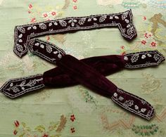 Antique Victorian dress trims silk velvet metal silver embroidered acorns plum purple shade curving shade mourning wear millinery cape