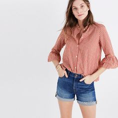 Red gingham checks, a banded collar, sweet bell sleeves—this is a classic button-down shirt made feminine.