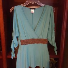 Top Very cute top with deeo v neckline and open sleeve.Leather braided front detail. Made of rayon and spandex. Boston Proper Tops Blouses