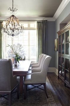 blue walls with dark ceiling. walls are Benjamine Moore puritan grey and ceiling is Texas taupe