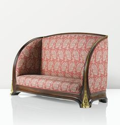 'ORCHIDÉES', A MAHOGANY AND GILT BRONZE SETTEE BY LOUIS MAJORELLE, CIRCA 1903. THE UNDERSIDE WITH ARTIST'S STENCILLED MARK.