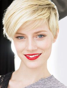 Such beautiful skin-- the red lips and pixie cut only emphasize her gorgeous skin.