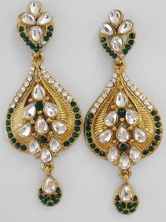 Exclusive earrings made of CZ and kundan. Available in 2 colors