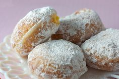 Paczki - (pronounced poonch-kee) - Polish doughnut with fruit filling (prunes, raisins, or fruit jams) & covered with powdered or granulated sugar.  Substitute any fruit juice for brandy, or pineapple juice with almond flavoring for rum.