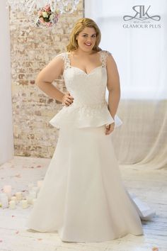 """Mermaid Plus Size Peplum Wedding Dress of satin and lace. Lace motifs cover bodice front and back and are applied to peplum. Peplum is detachable. Lace cut out sleeves make a beautiful touch for a curvy bride. Plus size wedding dress """" Ruby"""" By Glamour plus Designer Roz la Kelin. #plussize #rozlakelin #glamourplus"""
