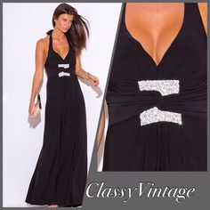 Black halter style maxi dress. Elegant black halter style dress . Deep V neck and ties at neck. Great addition to your wardrobe . A classy, polished  and sophisticated look. 95 % polyester and 5 % spandex. Figure flattering empire waist. Boutique Dresses Maxi