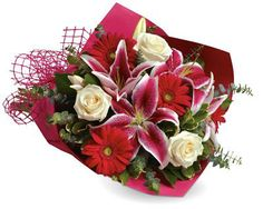 B26 Stolen Kisses. Show someone how much you love them with this gorgeous bouquet of lilies, roses and gerberas.