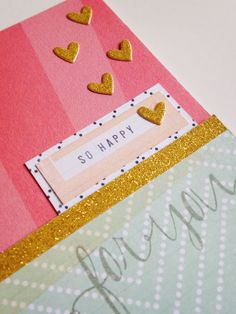 The gold glitter striped paper in the new Just Sayin' release from My Mind's Eye is perfect for decorative borders and punching/cutting tiny little hearts and other accents.