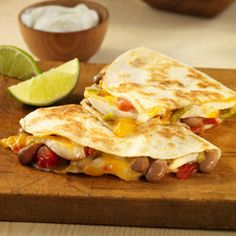 Quesadillas filled with chicken strips, pinto beans, zesty tomatoes and cheese for a simple meal