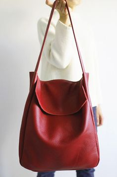 d54bb03ff494c Made of strong thick deep red leather. Inside without lining with one  pocket