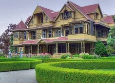 The Winchester Mystery House, San Jose, CA, designed by Sarah Winchester, heiress to the Winchester rifle fortune. This 160 room mansion was designed like a maze with mile-long hallways, secret passages, dead ends, doors opening to blank walls and staircases leading to the ceiling, in an effort to confuse the spirits of all the victims of Winchester rifles who had been haunting Sarah. She was instructed by a medium to never stop building the house, or else she would die.