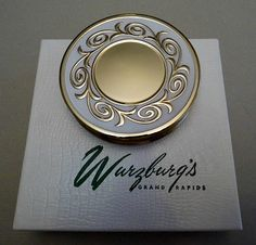 "Vintage Max Factor ""Creme Puff"", Round Goldtone and Enamel Powder Compact, Sold at Wurzburgs of Grand Rapids, Michigan, 2.875"" in Diameter, Made in USA."