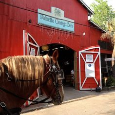 Visit the Palmetto Carriage Tours big red bard - one of 25 free things to do around Charleston.