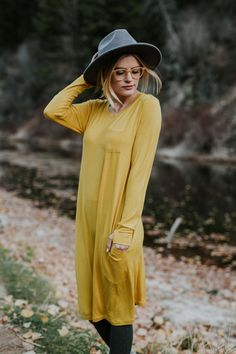 SAFFRON!!! Our signature Saffron color NOW available in a WILLOW DRESS! Little details like long sleeves with thumbholes and pockets make this dress not only versatile but functional. It layers easily with your favorite scarf or cardigan and begs to be paired with fashion tights or our cozy leggings. | @albionfit