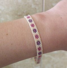 Items similar to Cream Seed Bead Bracelet with Purple and Pink Flowers on Etsy Pink Flower Girl Dresses, Pink Flowers, Peyote Patterns, Beading Patterns, Seed Bead Bracelets, Seed Beads, Bracelet Tutorial, Beading Tutorials, Loom Beading