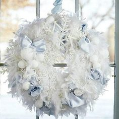 Beautiful Wreaths Begin with a hard white foam circle (ours was 21 inches wide). Use a white feather boa to cover the foam, attaching it with U-shape pieces of wire. Add ice-blue satin bows, and tuck in snowflake ornaments. To finish, spray hard white foam balls with artificial snow to resemble snowballs, and place them into the wreath with florist's picks.