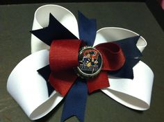 """Patriots boutique bow! 1.5"""", 7/8 spikes, 7/8 twisty top (I made the image on the cap!)"""