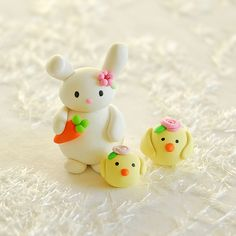 (will be cute in fondant too) Bunny and chicks of JooJoo land!    These 3 guys are made of polymer clay and the eyes are painted with acrylic colors.