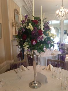 Romantic Candelabra display of Roses, Clematis, Lisianthus and Trachelium. Very Beauty & the Beast
