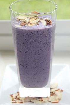 This protein smoothie helps Reduce belly fat because of the ingredients in it....blueberries, bananas, and almonds! Just looks so good!