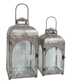 This 2 Piece Galvanized Metal Lantern Set is the perfect winter accent. The delicate white snowflake design makes it a timeless piece you can use year after year. Great for a coffee table, side table, mantel or anywhere you need winter flair.