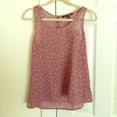Adorable rose tank top with birds With a half zip in the back and a quirky little shirt pocket in front, this adorable tank top is a must have. A dusty rose pink color, covered all over with black polka dots and happy little birds in white. Runs true to size and is in good condition. Forever 21 Tops Tank Tops