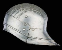 A Rare Italian Sallet  Of characteristic sou'wester form, with rounded one-piece skull with low medial ridge flanked by shallow flutes, and single riveted tail- and brow-plates meeting at the sides, the tail-plate pointed and the brow-plate with very shallow cusps along the upper edge curving up to a central point, the bottom edge turned inwards below an encircling rib 8¼in. (20.9cm.) high